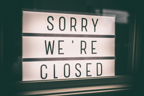 sorry we're closed window sign